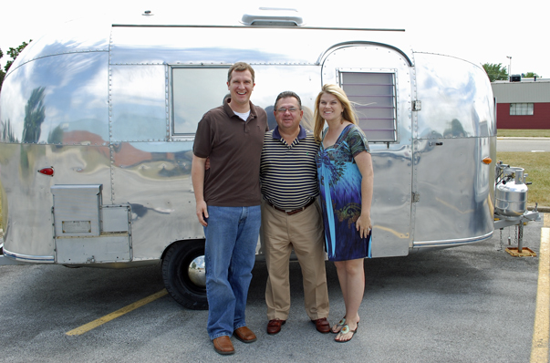 Behind us is one of Mr. Huttle's own personal Airstreams -- a 16-foot 1962 Bambi II. It's currently parked in front of company headquarters alongside some other historic units.